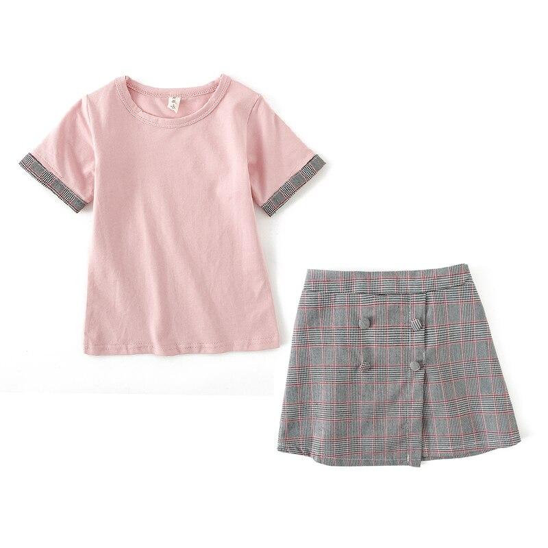 Alta qualidade novas meninas verão simples xadrez de duas peças roupas para crianças. Camiseta de manga curta + saia curta terno.