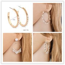 Europe and the United States New Winding Pearl Circle Earrings Creative Simple Retro Street Hand