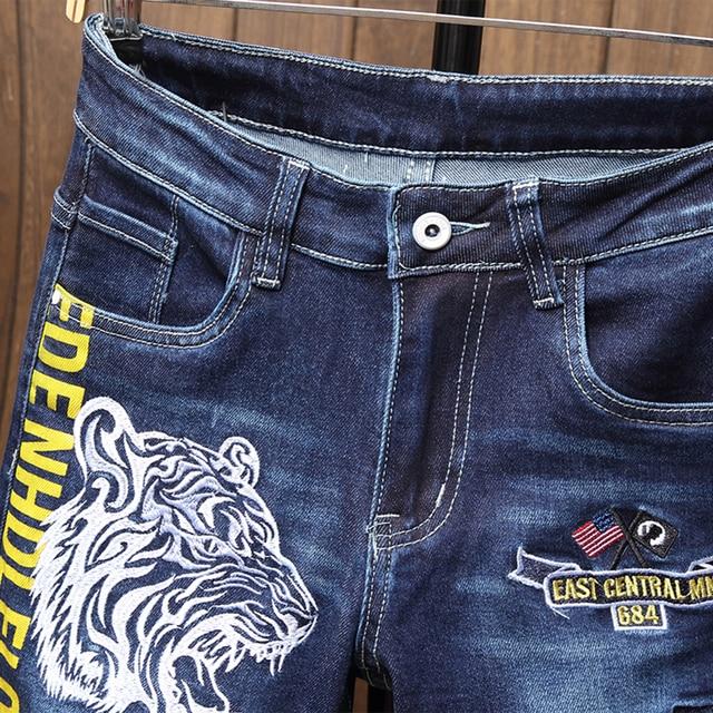 Pantalones vaqueros ajustados para hombre, pantalones ceñidos con estampado de motorista azul, informales, de chándal, a la moda 3