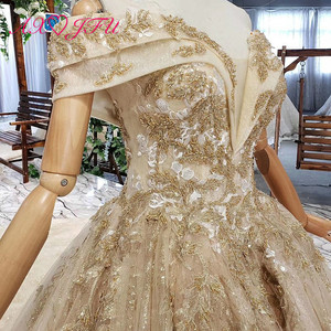 Image 5 - AXJFU Luxury princess golden flower lace boat neck beading crystal sparkly star bride tail wedding dress 100% real photo 11669