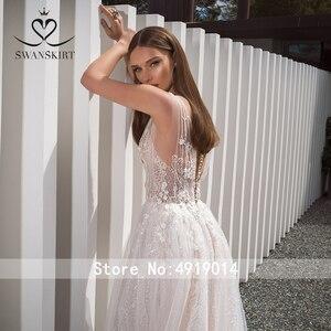 Image 2 - Романтический v образным вырезом Свадебное платье из фатина SWANSKIRT F261 бисерные, в стиле бохо аппликация с a линией 3D цветы иллюзия свадебное платье Vestido de noiva