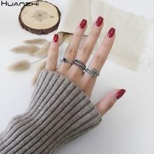 HUANZHI 2020 nueva forma de hoja de pluma ahueca hacia fuera los anillos de Metal tailandeses plata Retro anillo ajustable para las mujeres hombres joyería