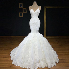 Exquisite Spaghetti Straps Heavy Beaded Floral Lace Floor Length Mermaid Wedding Dress Embellished with Feathers