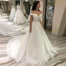 Роскошное платье принцессы свадебное 2020 с открытыми плечами