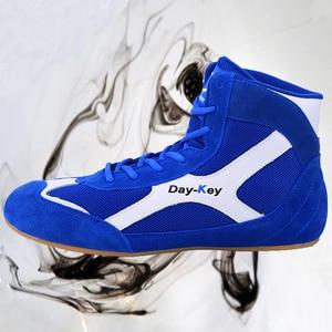 Zapatos de lucha de alta calidad para hombre, calzado de boxeo de cuero suave, suela de músculo de vaca transpirable, zapatillas de lucha profesional