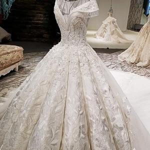 Image 4 - LS59840 see through scoop neck 2018 new design satin cap sleeve big heavy skirt super long train corset back wedding dress