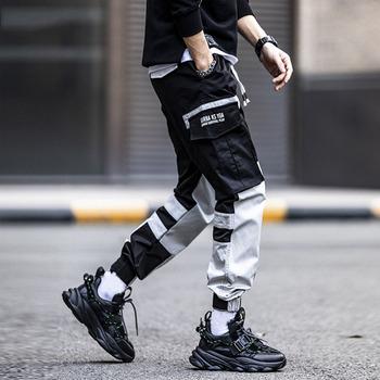 Spodnie Harajuku mężczyźni japonia modne spodnie dresowe główna ulica spodnie dresowe na co dzień spodnie Cargo mężczyźni hiphopowe spodnie dresowe spodnie 2021 tanie i dobre opinie TIKALIA summer CN (pochodzenie) POLIESTER COTTON Na zakupy elegancki Mieszkanie Z KIESZENIAMI REGULAR Pełna długość
