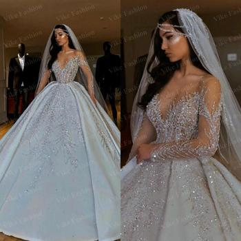 Luxurious New 2020 African Wedding Dresses Sheer Neck Long Sleeves Bridal Dresses Beaded Sequins Satin Wedding Gowns