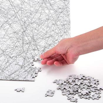 a hand placing the last pieces to the lines puzzle