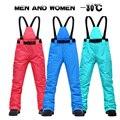 Женские лыжные штаны  брендовые новые спортивные штаны на подтяжках высокого качества  мужские ветрозащитные водонепроницаемые теплые зим...