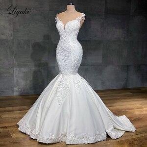 Image 1 - Liyuke 2020 projektant syrenka suknia ślubna prawdziwa praca całe z koralików suknia ślubna makijaż