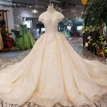 LSS117 light champagne wedding dresses o-neck cap sleeves ball gown appliques flowers hot sales keyhole wedding gown with train(China)