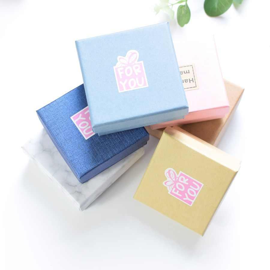 Fabricantes de caja de joyería de venta directa Kraftpaper blanco y negro con anillo de patrón de pulseras de perno de oreja collar caja de joyería
