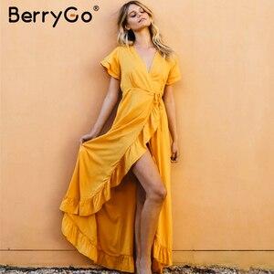 Image 1 - BerryGo Sexy v neck ruffled boho dress women Cotton short sleeve holiday beach maxi dress Casual solid yellow summer wrap dress