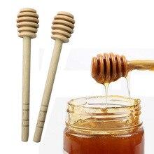 цена 2pcs High Quality Honey Stir Bar Mixing Handle Jar Spoon Practical 1Pc Wood Dipper Honey Long Stick Supplies Honey Kitchen Tools онлайн в 2017 году