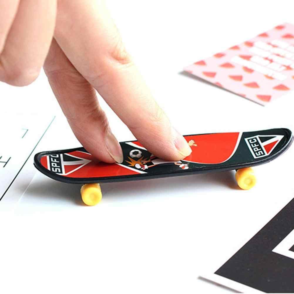 Juguetes educativos para niños movimiento creativo de la punta de los dedos tablero de dedo Mini dedo Skateboard aleación Skate Board Color al azar