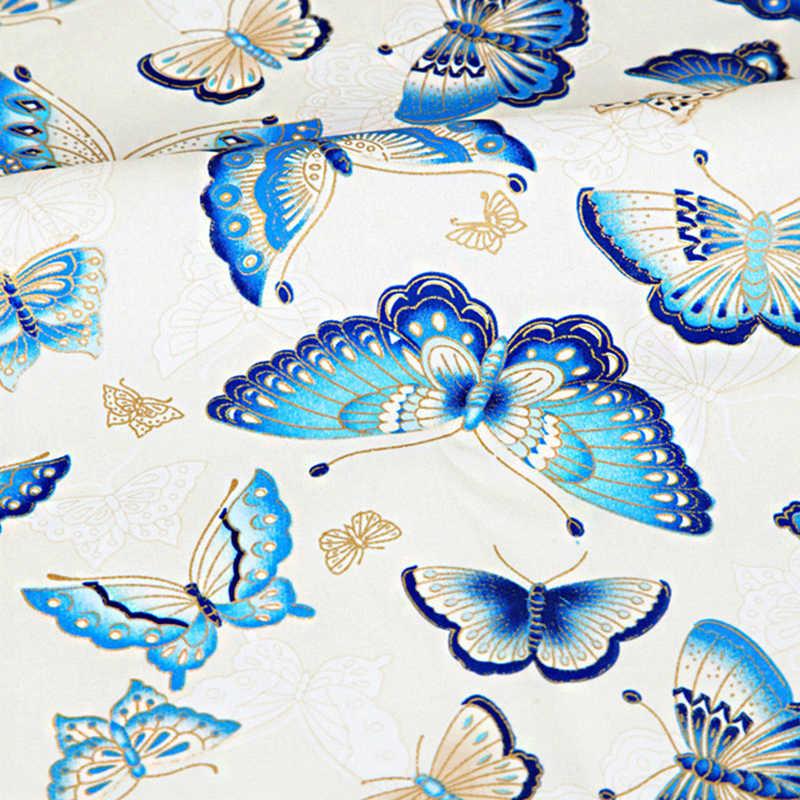 Tela bronceada de algodón mariposa azul blanco, tejido de costura precortado parches acolchado DIY tela japonesa
