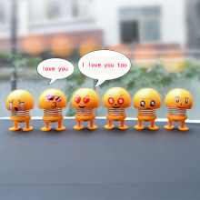 Decompression Car Interior Decoration Shaking Head Small Yellow Man Expression Pack Spring Smiley Doll Steam Creative
