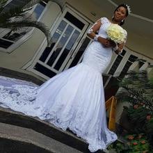 2020 イリュージョン長袖アフリカのウェディングドレスマーメイドレースアップリケウェディングドレスvestidosデ · ノビアビーズブライダルドレス