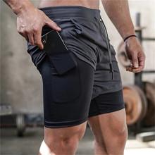 Męskie szorty podwójne szorty do biegania męska 2-in-1 szorty siłownia zbudowany w kieszeniach szybkoschnące szorty plażowe męskie spodnie sportowe tanie tanio MENGD G O S CN (pochodzenie) Na co dzień Poliester Sznurek Stałe REGULAR Kieszenie