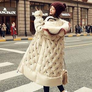 Image 1 - 100% piume danatra bianca giacca femminile modelli di esplosione di inverno di volpe naturale grande collo di pelliccia lungo tratto di spessore donna down jacket
