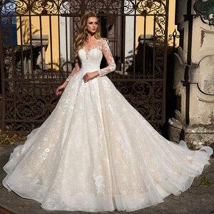 Image 1 - 長袖アップリケレース a ラインのウェディングドレス vestido ブランコボタン床の長さの王女のウェディングドレス血
