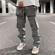 Główna ulica multi-pocket spodnie typu Casual dla mężczyzn i kobiet boczne piersi sznurkiem Cargo spodnie Harajuku jednolite, luźne spodnie
