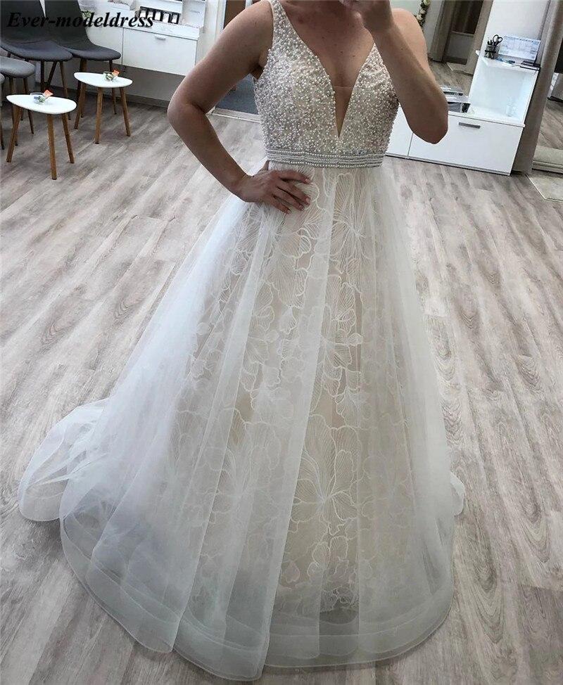Unique Lace Wedding Dresses V-Neck Sleeveless Pearls Beaded Lace-Up Back Bridal Gowns Plus Size Vestidos De Novia 2020