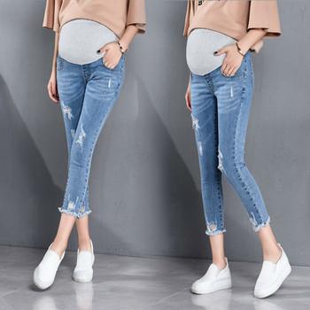Nowe ubrania ciążowe elastyczne miękkie jeansy ciążowe spodnie ciążowe Skinny Fashion Hole spodnie spodnie damskie w ciąży dżinsy tanie i dobre opinie BAHEMAMI Denim Natural color light REGULAR COTTON Przycisk fly Autumn stomach lift