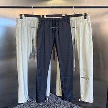 2021 verão calças casuais dos homens novos de alta qualidade designer marca alta rua hip hop solto náilon logotipo reflexivo calças esportivas