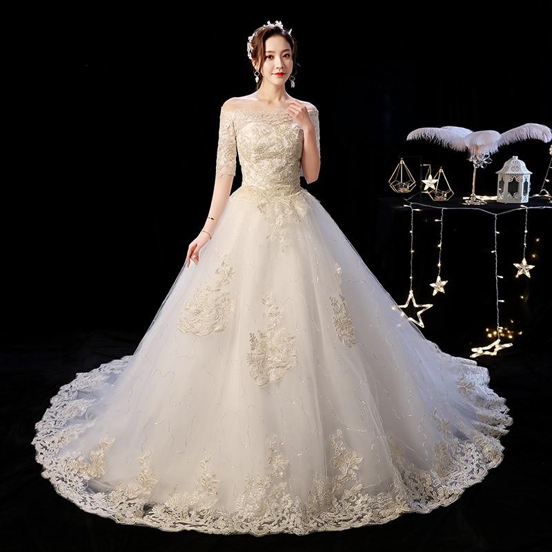 Fashion Buteaful Elegance GOLD Lace Appliques Boat Neck Off Shoulder Wedding Dress 2020 Vestidos De Novia Half Sleeve Sweet Gown