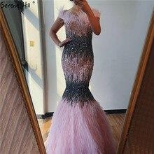 두바이 핑크 섹시한 머메이드 이브닝 드레스 디자인 럭셔리 크리스탈 깃털 민소매 공식 가운 2020 고요한 힐 LA70242