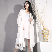 [EWQ] New 2020 Spring Summer Fashion Loose White Solid Color Hollow Out Tassel Tie Lantern Sleeve Wo