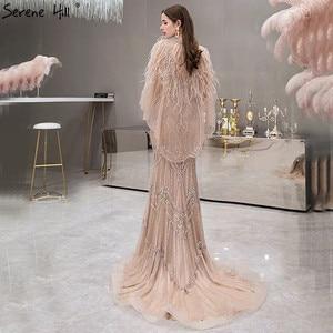 Image 2 - 高級シルバーヌード V ネックマーメイドイブニングドレス 2020 ノースリーブショール糸羽セクシーなフォーマルドレス穏やかな丘 LA70171