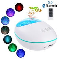 Lucky Stone Ocean Wave Projector 12 LED 8 Colors Changing Remote Control Night Light Projector With Built in Music Player