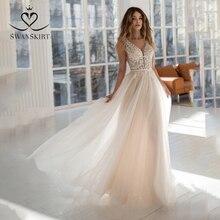 Seksi boncuklu Backless düğün elbisesi Swanskirt NR22 v yaka aplikler dantel A Line mahkemesi tren prenses gelin kıyafeti Vestido de Noiva