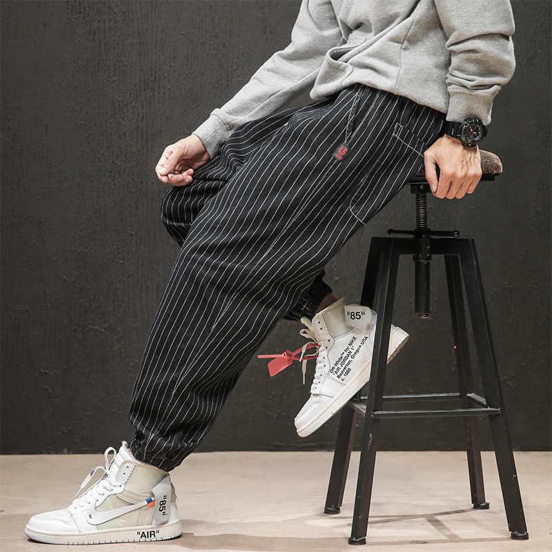 Свободные джинсы модные мужские рваные искусственно состаренные брюки