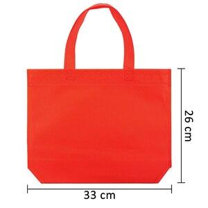 Image 3 - 10PC wielofunkcyjny prezent duże torba z rączkami dzieci Birthday Party favor włókniny torby na prezent 7 jednolity kolor z uchwytem torba na zakupy DIY prezent torba