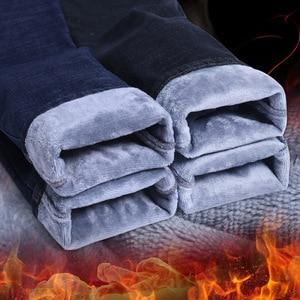 Image 1 - 2020 hommes mode hiver jean hommes noir Slim Fit Stretch épais velours pantalon chaud jean décontracté polaire pantalon mâle grande taille