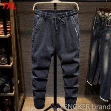 Siyah büyük boy kot erkekler artı boyutu kolej harem pantolon sonbahar elastik streç ayak pantolon 7XL 6XL 5XL