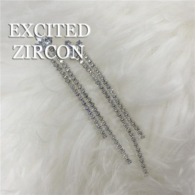 Фото модные изысканные длинные в полоску с клевером кисточками циркон цена