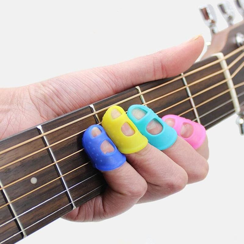 4pcs Guitar Fingertip Protector Fingerstall Silicone Guitar String Finger Guard Protection Press Ukulele Bass Guitar Accessories
