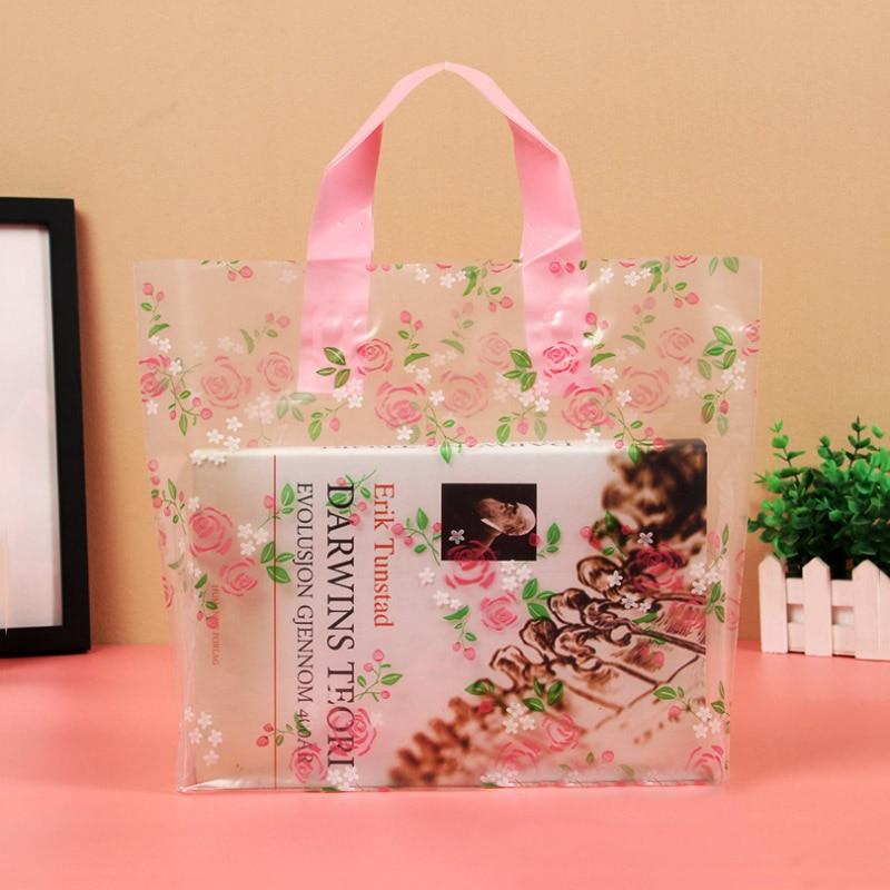 Haute qualité en plastique transparent sac cadeau Rose Rose fleur sac à provisions avec poignées grande taille vêtements poignée sacs 50 pcs/lot