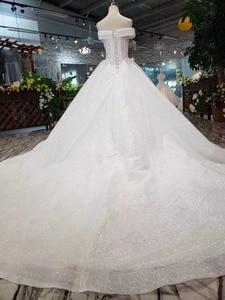 Image 2 - BGW HT5622 סטרפלס חתונת שמלות Boho כבוי כתף מחוך לבן מבריק שמלות כלה עם רכבת אופנה חדשה Vestidos דה Novia