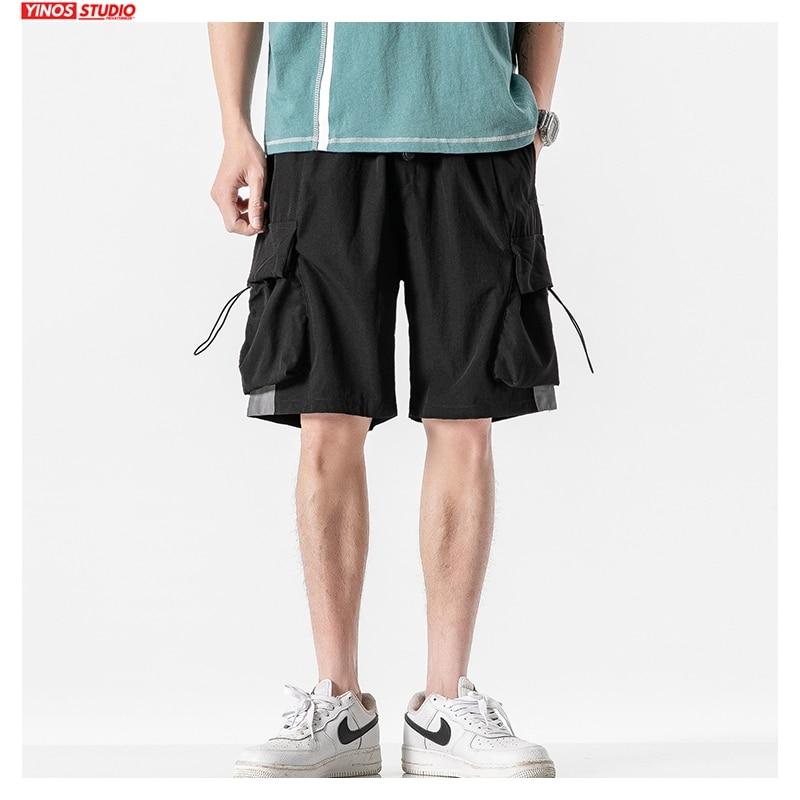 Dropshipping 2020 Men Summer Pockets Shorts Men Korean Loose Safari Style Sweatpants Male Oversized 5XL Clothes Casual Shorts