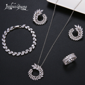 Image 1 - 4 Pcs Leaf Shape Fashion CZ Necklace Earring Bracelet and Ring Sets Brand Zirconia Silver Color Jewelry Sets Women Accessories