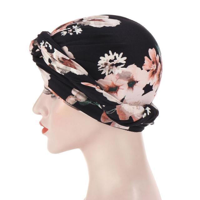 новая шелковистая шапка тюрбан с вышитым бисером цветком и крестиком фотография