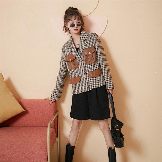 Шикарная универсальная клетчатая куртка в английском стиле с