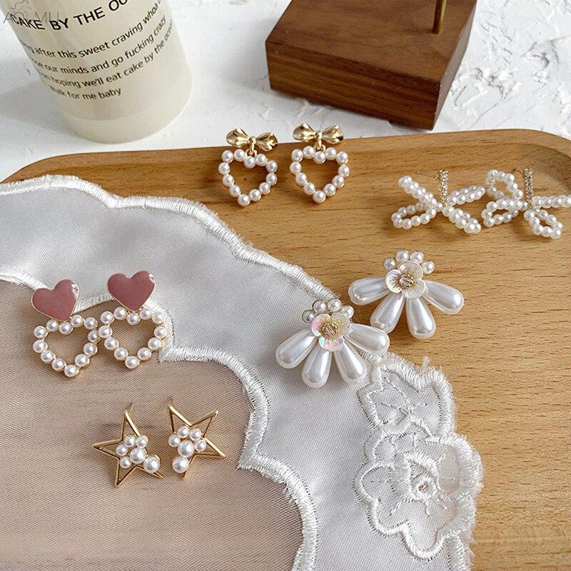 AOMU Japan Korean Fashion Pearl Bow Flower Hollow Star Enamel Love Heart Stud Earrings 2019 For Women Girl Party Jewelry Brincos(China)