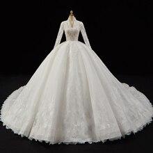 קריסטל פניני אפליקציות תחרה מדהים כדור שמלת חתונת שמלות V צוואר ארוך שרוול יוקרה כלה שמלות